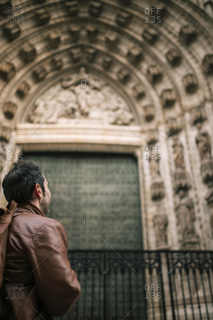 Young tourist man looking at architecture in Europe