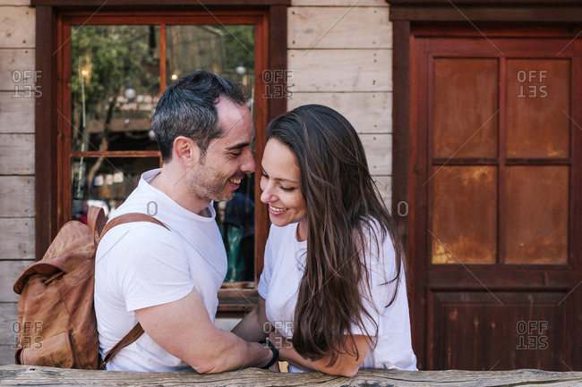 Young couple in love on a wooden porch