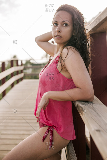Attractive young woman in a bathing suit in a passage on a beach in Spain