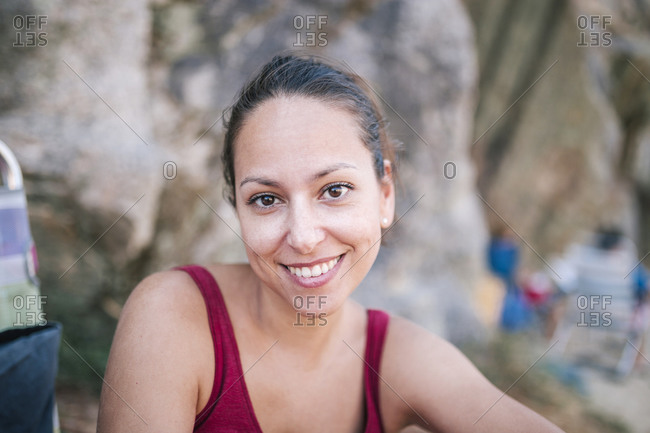 Portrait of young woman smiling in nature in summer