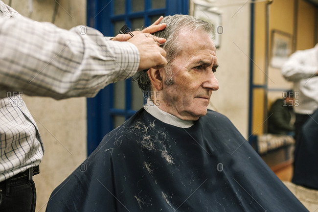Senior man in a barber shop getting a haircut