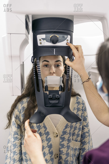 Unrecognized dentist using x-ray machine with patient.