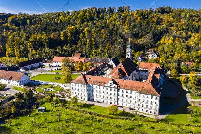 Germany- Bavaria- Schaftlarn- Helicopter view of Schaftlarn Abbey on sunny autumn day