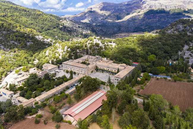 Spain- Mallorca- Escorca- Helicopter view of Santuari de Lluc in forested valley of Serra de Tramuntana range