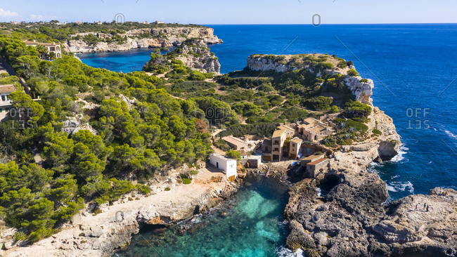 Spain- Mallorca- Santanyi- Helicopter view of coastal village in summer
