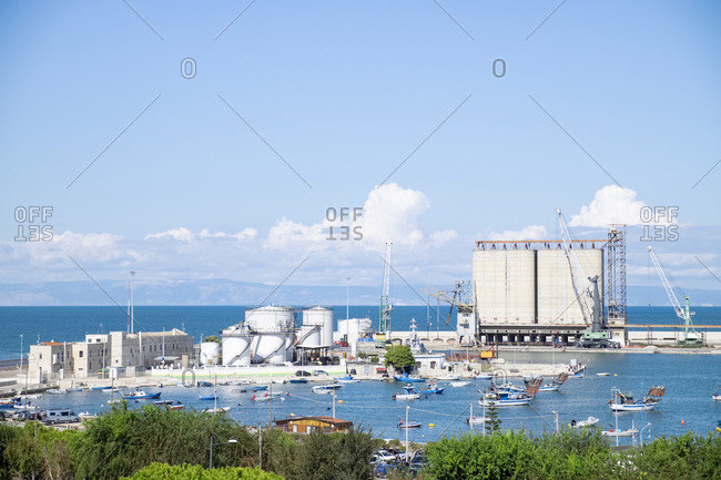 Italy- Apulia- Barletta- Boats in front of commercial dock