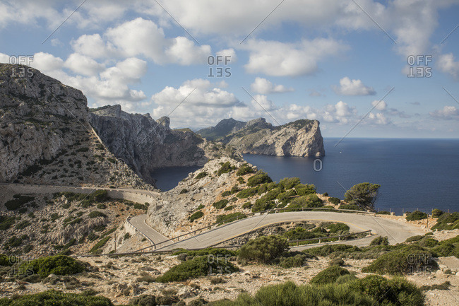 Empty road winding along edge of Cap de Formentor headland
