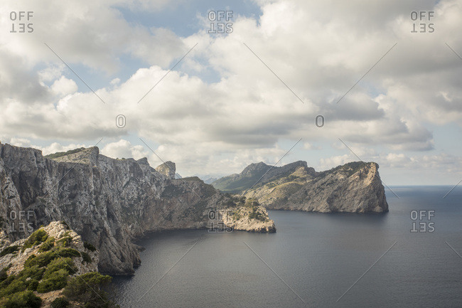 Scenic view of clouds over tall coastal cliffs of Cap de Formentor