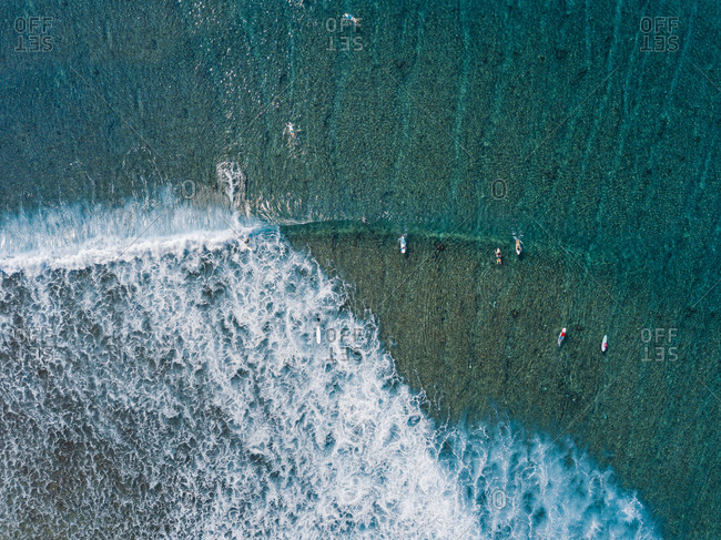 Surfers on sea waves- aerial view