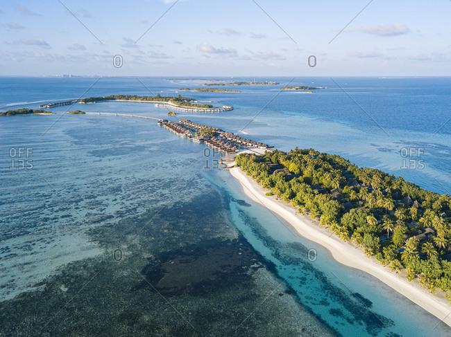 Maldives- Kaafu Atoll- Aerial view of green grove on Huraa island