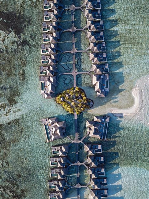 Maldives- Kaafu Atoll- Aerial view of bungalows of tourist resort on Huraa island