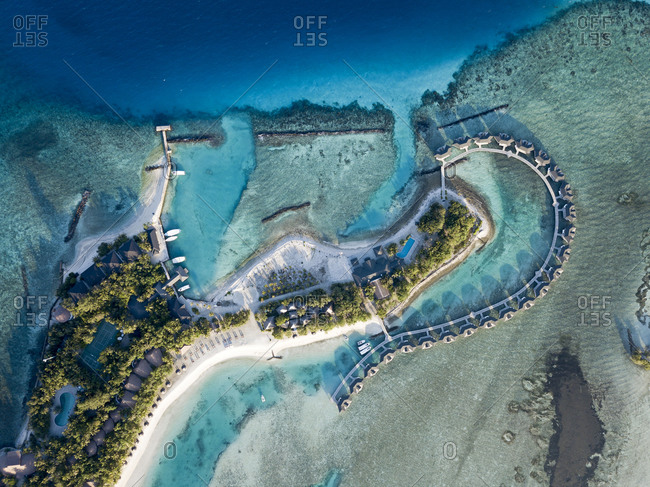 Maldives- Kaafu Atoll- Aerial view of bungalows of tourist resort on Kanuhuraa island
