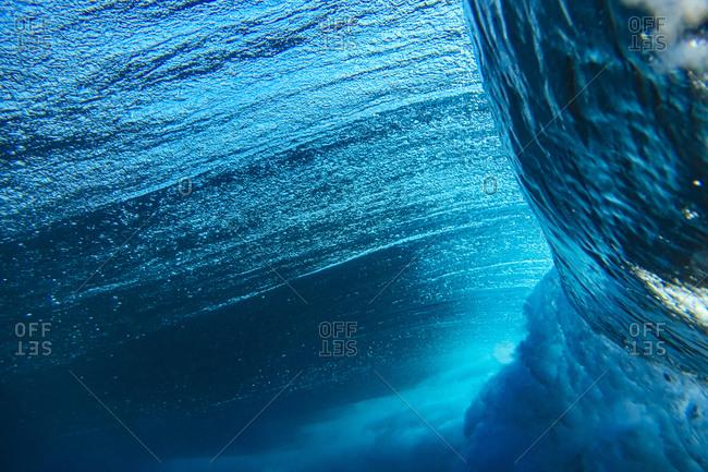 Underwater view of splashing sea wave