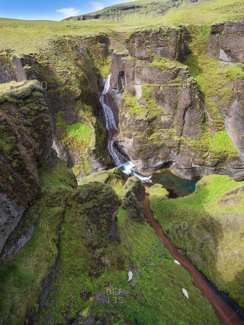 Scenic view of Fjadra river flowing through Fjadrargljufur canyon