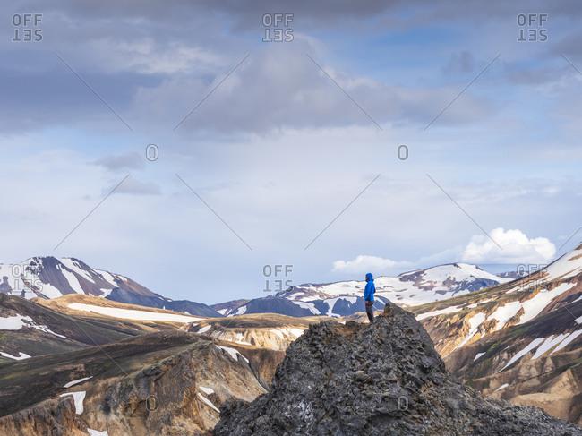Hiker standing on top of volcanic hill in Landmannalaugar