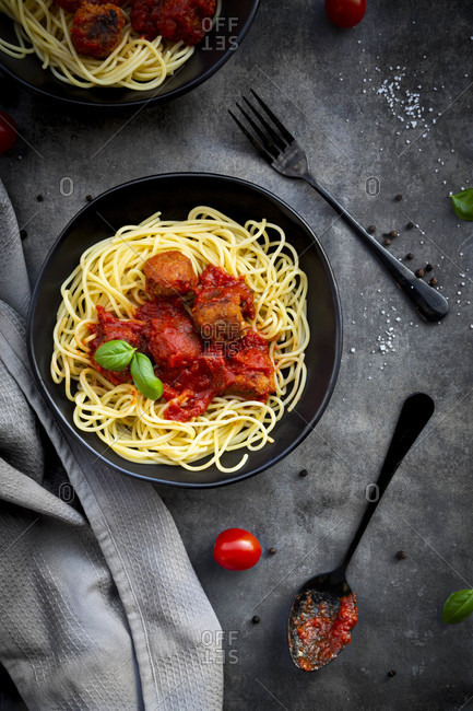Bowl of spaghetti with vegetarian polpette and basil