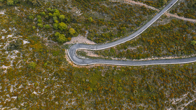 Aerial view of hairpin curve of mountain road