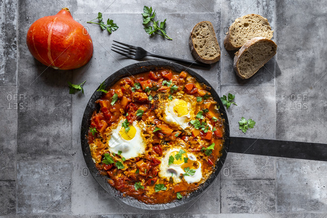 Frying pan with fresh ready-to-eat pumpkin shakshuka