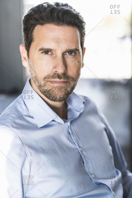 Confident businessman staring while sitting at office