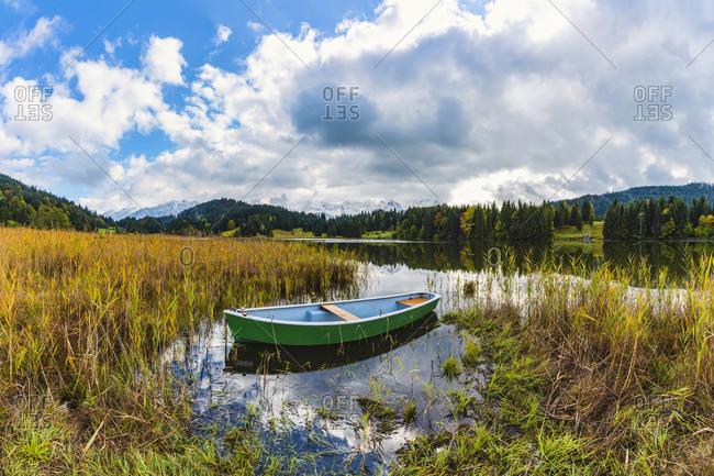 Rowboat floating in grassy shore of Geroldsee lake