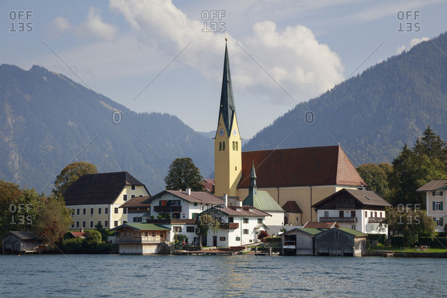 Germany- Bavaria- Rottach-Egern- Town on shore of Tegernsee lake with mountains in background