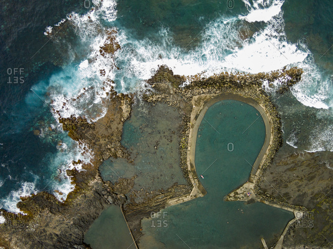 Natural water pool by the Atlantic Ocean viewed from above