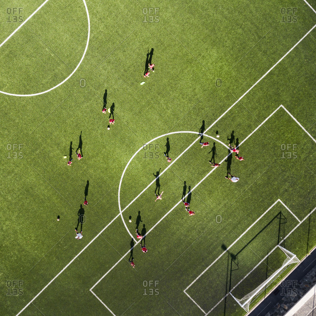 Kids practicing before a soccer game in the stadium