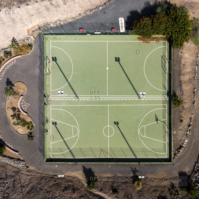 Sports playground with green soccer and basketball courts
