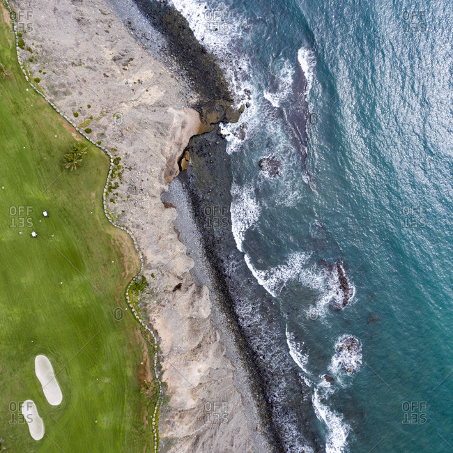 Arial view of golf course by the ocean