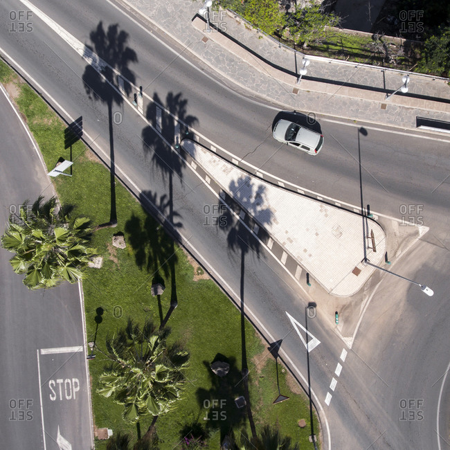 Bird's eye view of car driving on the streets in the city