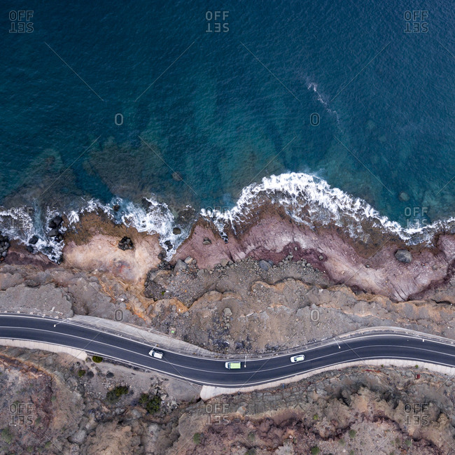 Coastal winding road by the ocean viewed from above