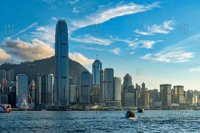 Views of Hong Kong skyline from Victoria Harbor at sunset