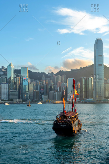 May 19, 2018: An old vessel sailing with Hong Kong skyline behind