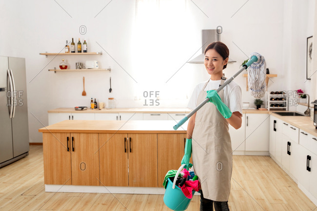 Domestic service personnel ready to clean room