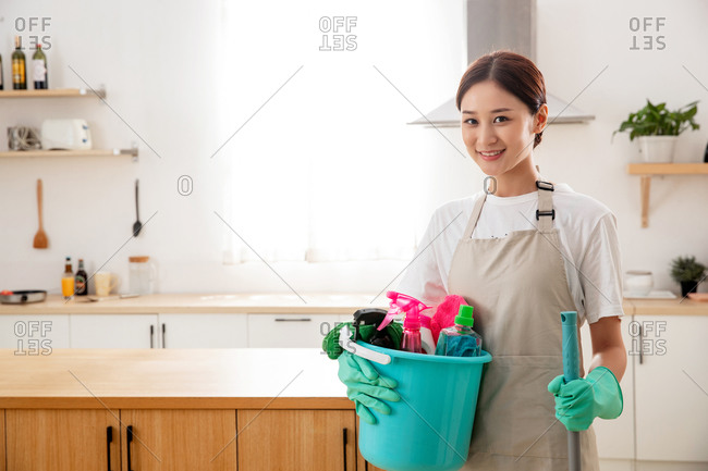 Young woman ready to clean the room
