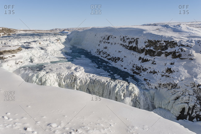 "Wintry waterfall ""Gulfoss Falls"" in Iceland"