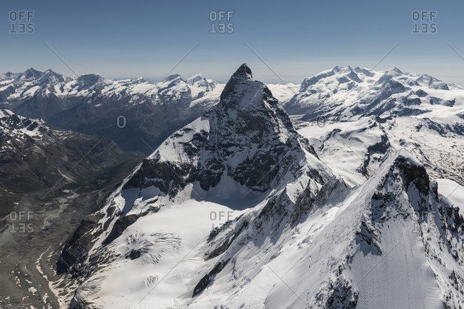 Italy, Piedmont, Switzerland, canton Valais, Valais Alps, Zermatt, in the foreground Dent d'Herens from above and Matterhorn from the west with Liongrat and Zmuttgrat, in the background cathedral,