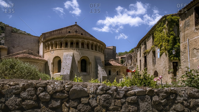 May 23, 2017: Gellone monastery in Saint Guilhem le Desert in spring. The grounds were built in the 9th century and are recognized as part of the UNESCO World Heritage Site Jakobsweg in Frankreich