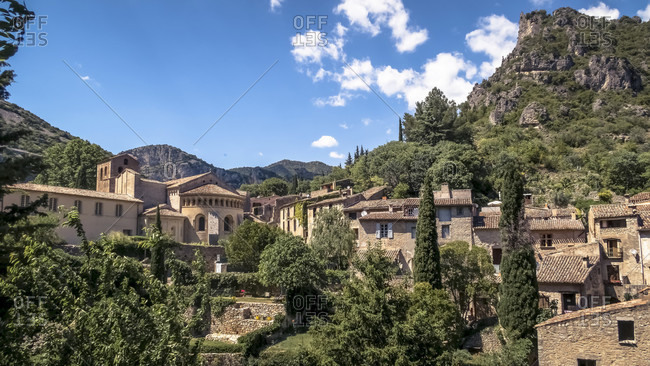 Gellone monastery in Saint Guilhem le Desert in spring. The grounds were built in the 9th century and are recognized as part of the UNESCO World Heritage Site Jakobsweg in Frankreich