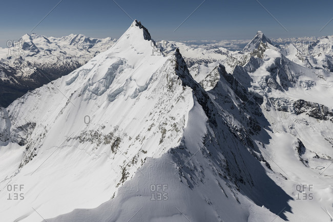 Switzerland, canton of Valais, Valais Alps, in the foreground Weisshorn Nordgrat, in the background Monte Rosa, Liskamm, Castor, Zinalrothorn, Obergabelhorn, Matterhorn and Dent d'Herens