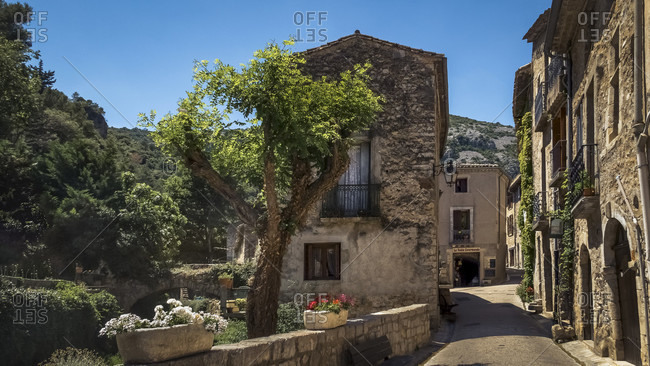 May 23, 2017: Village alley in Saint Guilhem le Desert in spring. The village belongs to the Plus Beaux Villages de France. Located on the pilgrimage route to Santiago de Compostela.