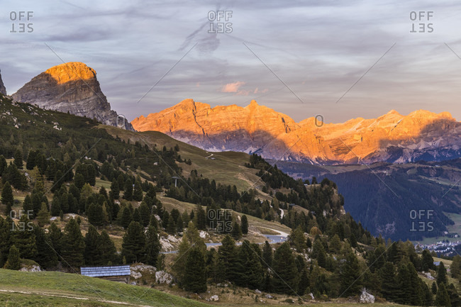 View from the Gardena Pass to the Sassongher (2665m) in the Puez Group and to La Varella (3055m) in the Kreuzkofel Group at sunset, Bolzano province, Trentino-South Tyrol, Italy