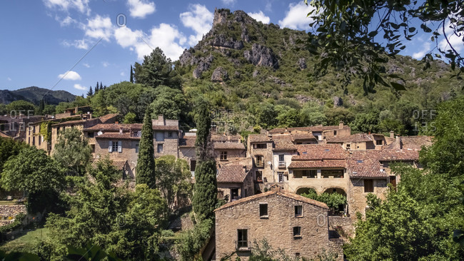 View of the village of Saint Guilhem le Desert in spring. The village belongs to the Plus Beaux Villages de France. Located on the pilgrimage route to Santiago de Compostela.