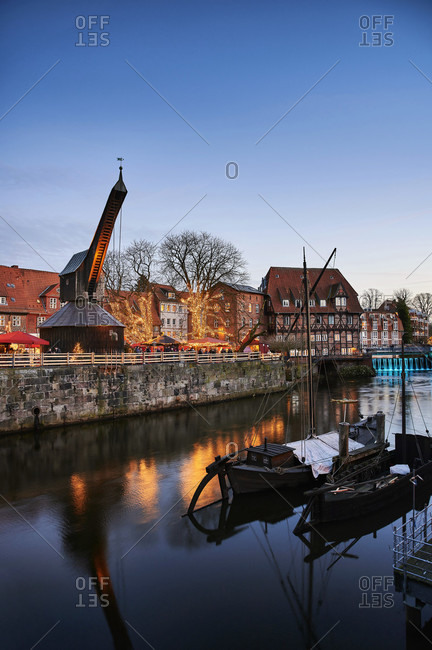 City view, Luneburg, old town, water district, Am Stintmarkt, Am Fischmarkt, The Old Crane, landmark, illuminated, Christmas, Christmas market, night shot, portrait format