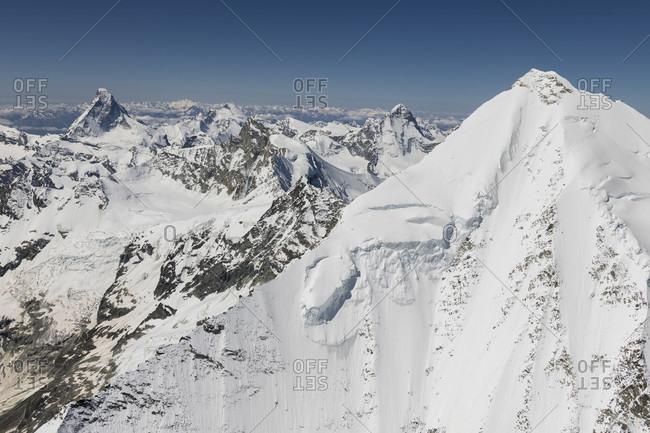 Switzerland, Valais canton, Valais Alps, Weisshorn Ostgrat in the foreground, Matterhorn, Dent d'Herens, Obergabelhorn, Zinalrothorn and Dent Blanche in the background