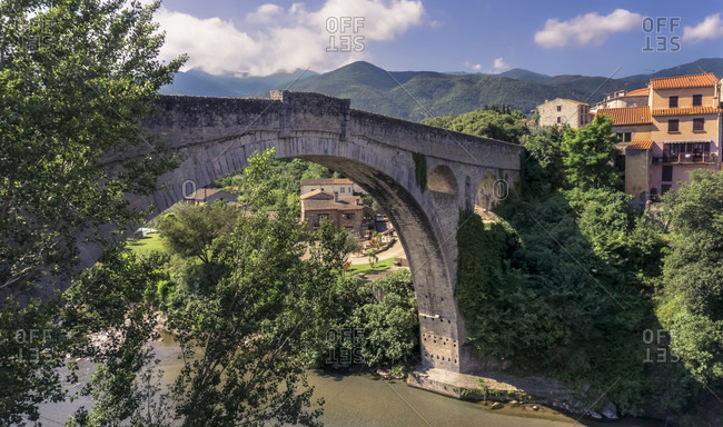 Le Pont du Diable over the Tech river at Ceret. The single-arch stone bridge was built in the XIV century and its only arch is 45 meters wide. Monument historique.