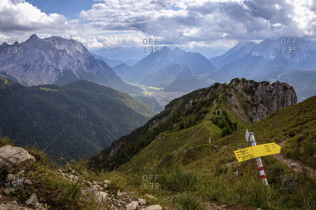 July 19, 2020: Hiking trail to Mittenwald with a view of the Signal Head, the Karwendel, the Great Arnspitze, the Wetterstein Mountains and Mittenwald