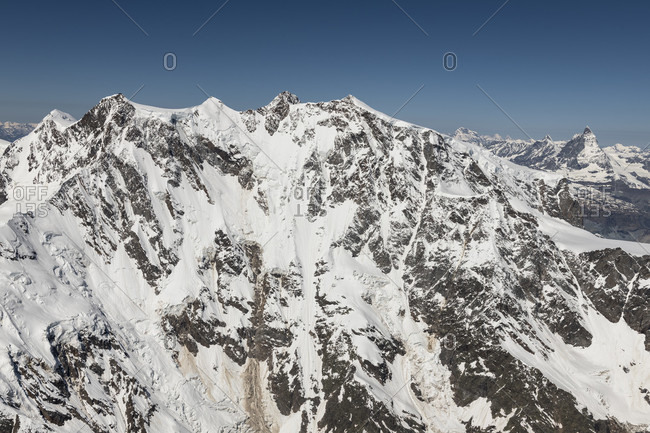 Italy, Piedmont, Switzerland, Canton of Valais, east face of the Monte Rosa massif, in the background Grand Combin, Dent d'Herens and Matterhorn