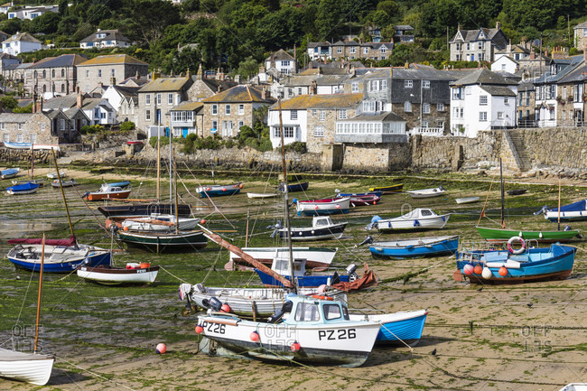 June 26, 2018: Harbor at low tide in the small fishing village of Moushole, Cornwall, England, Great Britain, British Isles, United Kingdom, UK