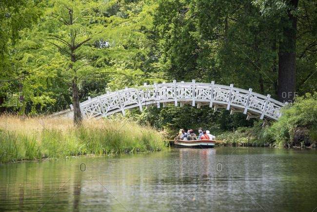 July 7, 2020: Germany, Saxony-Anhalt, Worlitz, tourists ride gondolas through the canals of the Worlitz Garden Realm, Unesco World Heritage.